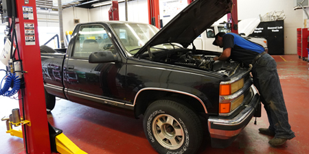Auto tech working on truck