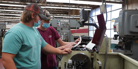 Two students in Machine Tool Lab