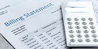 adding machine and billing statement