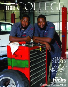 cover with two automotive students