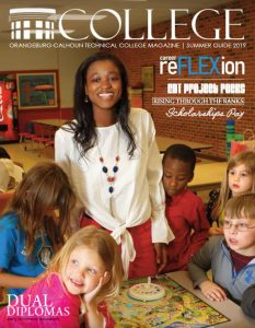 cover with female teacher ed student in classroom