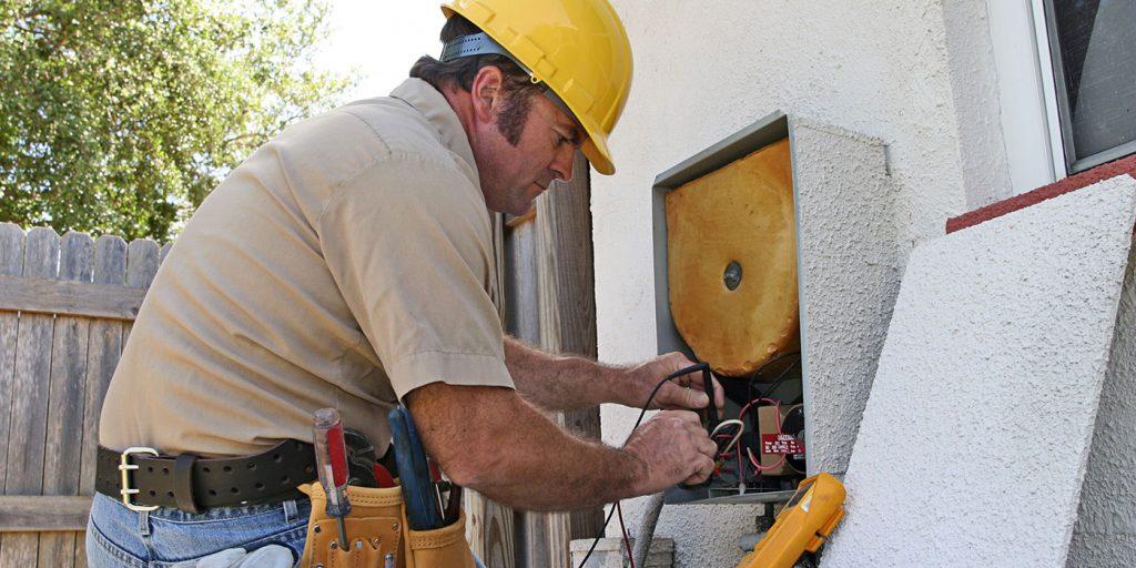 HVAC man servicing AC  unit